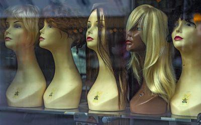 Wigs in store window