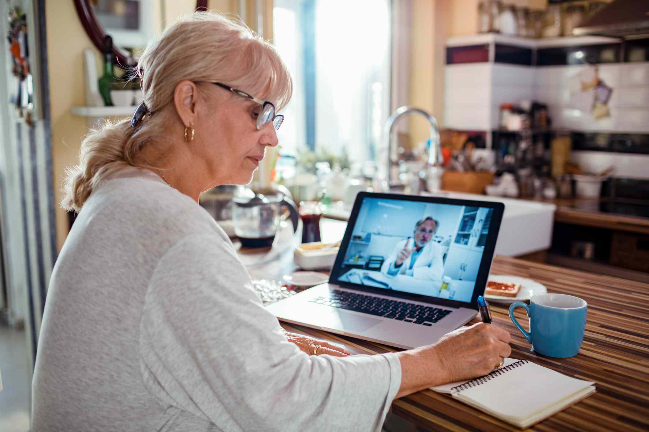 Senior woman consulting with her doctor online