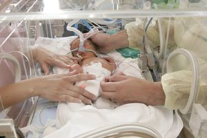 Doctor working on premature baby