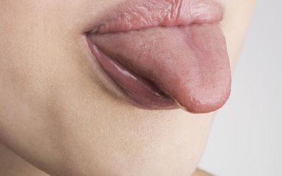 A tongue sticking out of a mouth