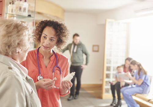 older patient talking to doctor