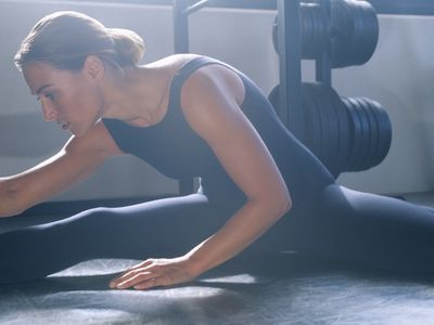 Photo of a woman stretching her hamstrings.