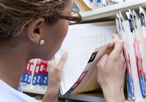 Nurse checking medical records
