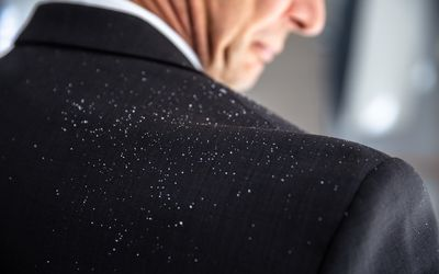Dandruff Fallen On Businessperson's Shoulder