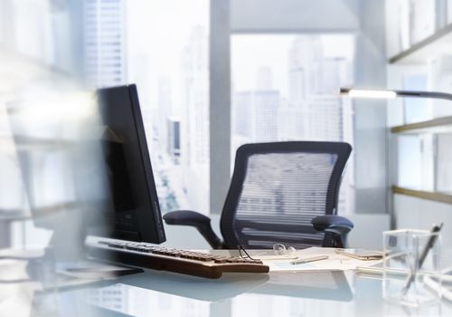 Office desk with computer and chair