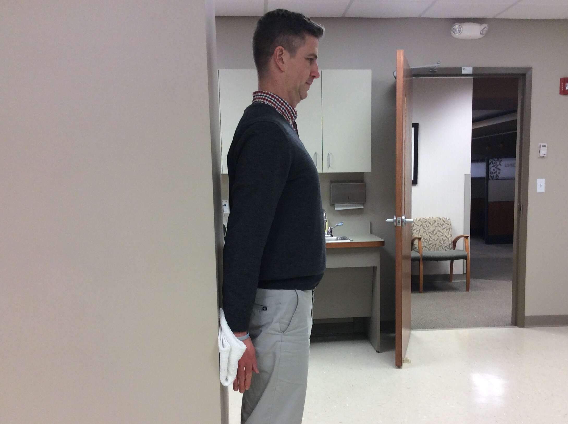 Physical therapy shoulder isometric extension exercise.