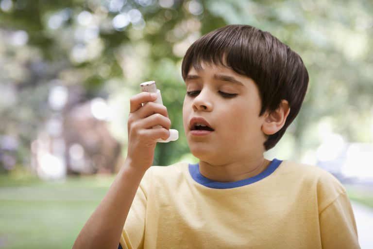 Small boy with inhaler