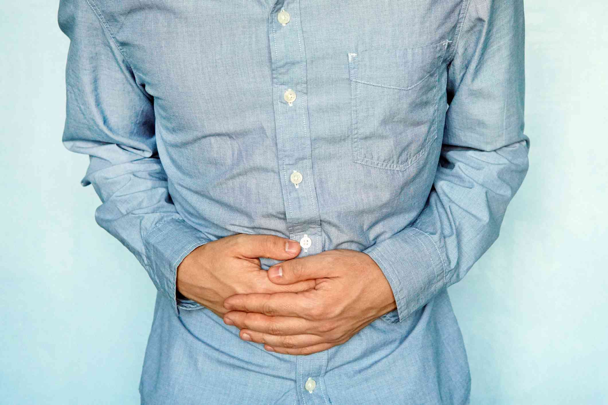 Man holding his stomach in pain