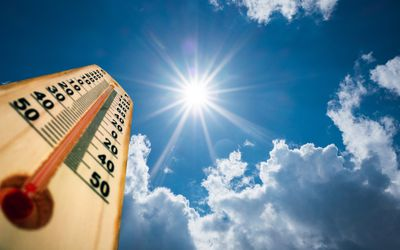 Thermometer against a sunny sky