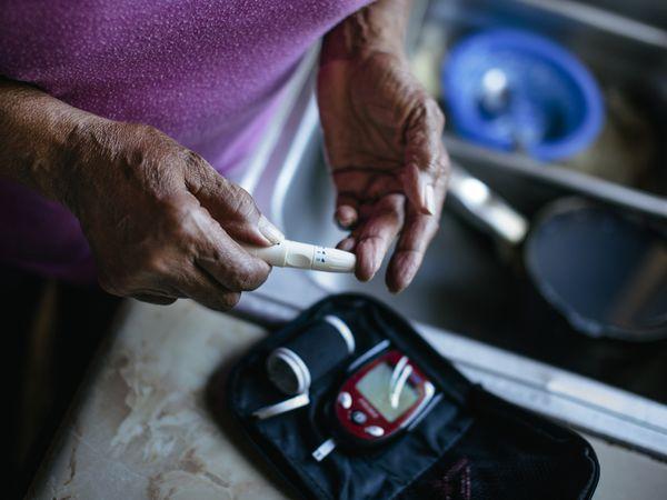Woman checks blood sugar levels.