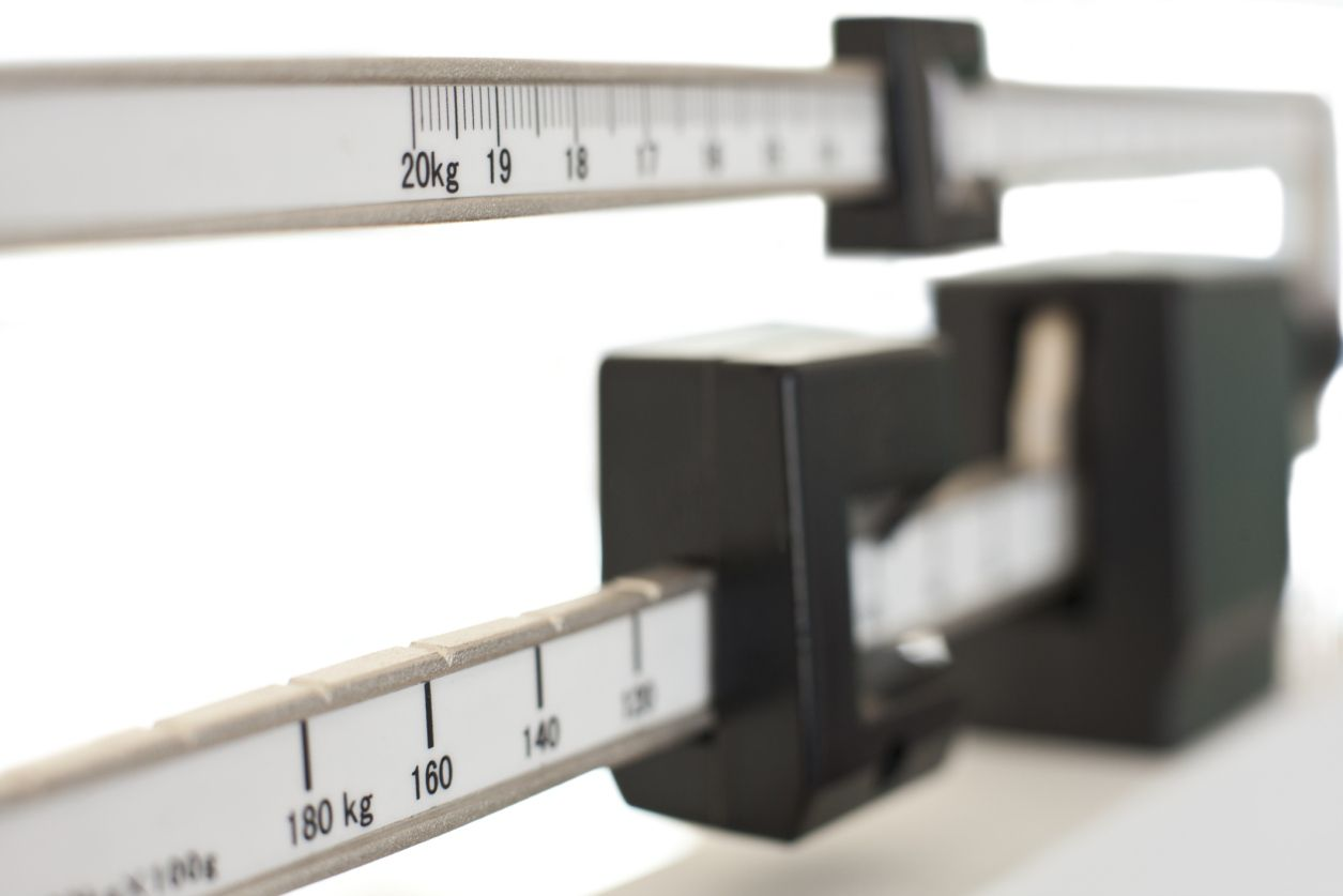 Close up of the sliding weights on a medical scale