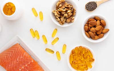 Fish oil capsules, walnuts, chia seeds, salmon, and almonds
