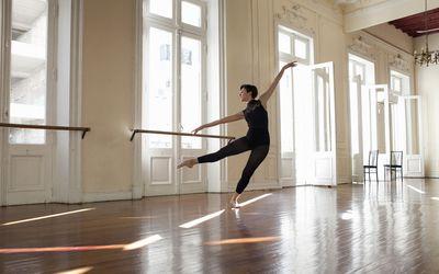 Ballerina dancing in beautiful rehearsal room