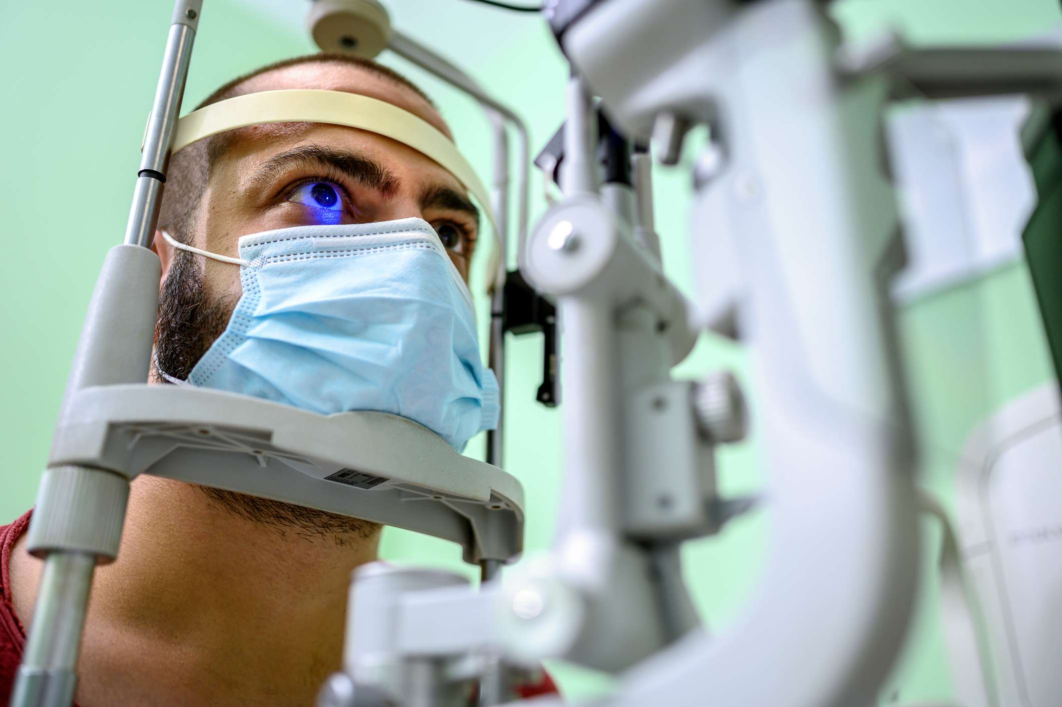 Man having an eye exam at ophthalmologist's office