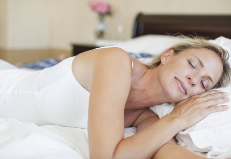 Mature woman in bed sleeping peacefully