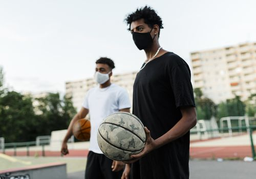 Basketball players wearing face masks.