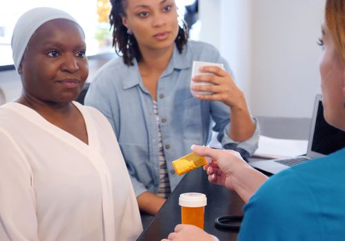 Woman with cancer getting medicine