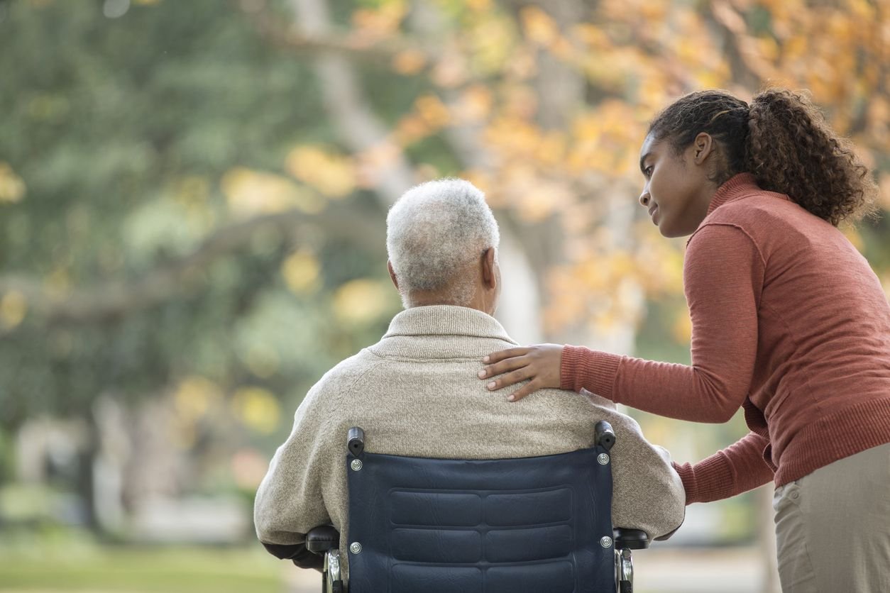 Caregiver with man in wheelchair