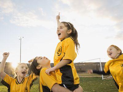 Girls soccer team celebrating success