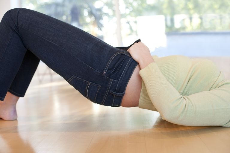 Woman Buttoning Jeans from the floor