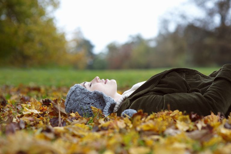 Woman resting on leaves