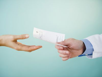 prescription being handed to a patient
