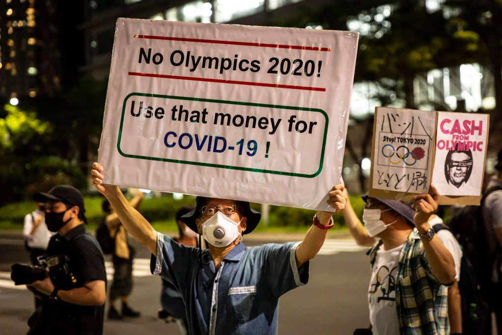 A man holding a placard marches during a demonstration against the forthcoming Tokyo Olympic Games on July 16, 2021 in Tokyo, Japan.
