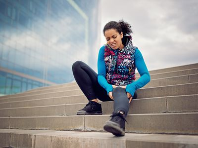 Sportswoman with broken leg sitting on ground,Barcelona