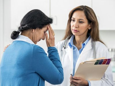 Middle Eastern doctor examining patient in office