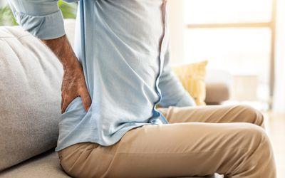 Unrecognizable mature man having backache.