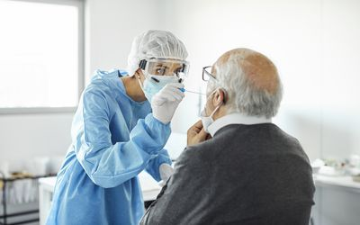 Older man being tested for COVID-19.