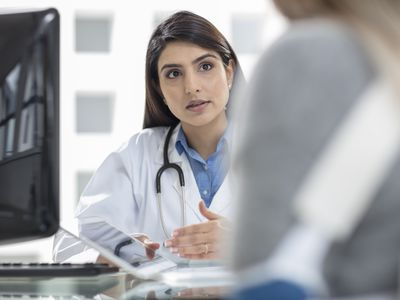 Female doctor having discussion with patient