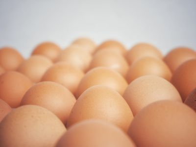 Close-Up Of Brown Eggs Against Black Background