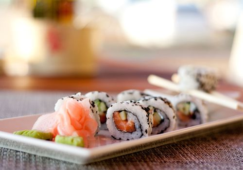 Japanese seafood sushi, roll and chopstick on white plate
