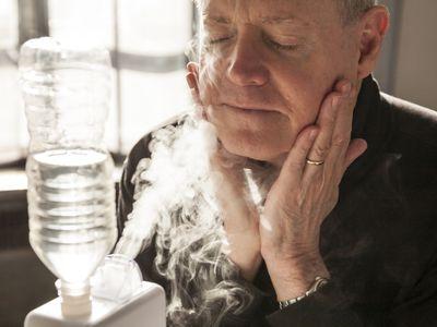 Man using humidifier