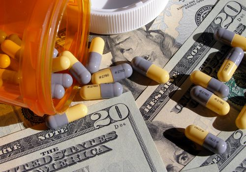 Pills on twenty dollar bills