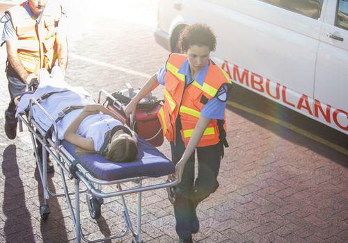 Paramedics helping patient