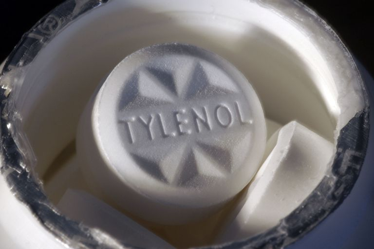 close up of tylenol tablet