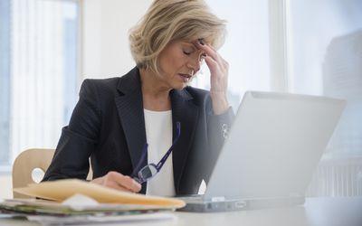 A woman at work suffering from a nummular headache