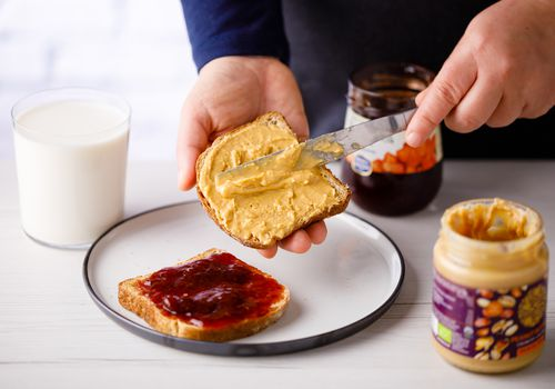 Milk with peanut butter and jelly sandwich