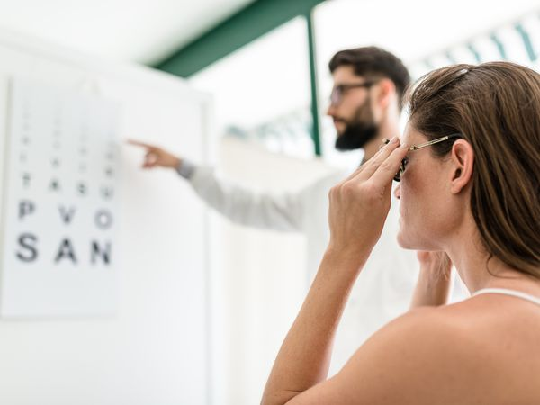 Ophthalmologist doctor with the snellen chart