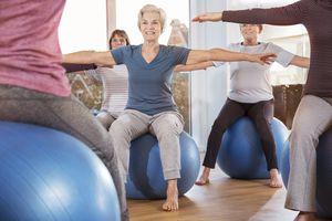 Senior women doing ore stabilization workout on exercise balls