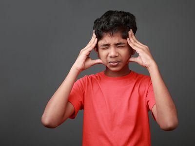 a young boy with a headache