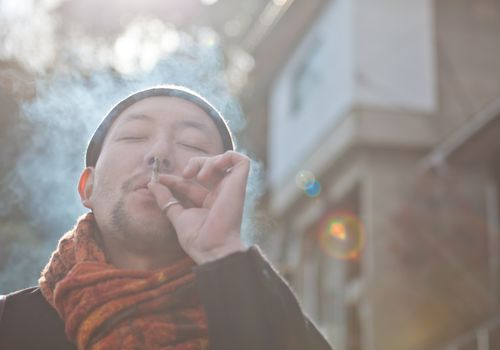 Asian man smoking but less likely to get lung cancer than American men