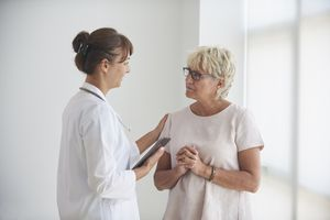 Female doctor delivering good news to mature female patient