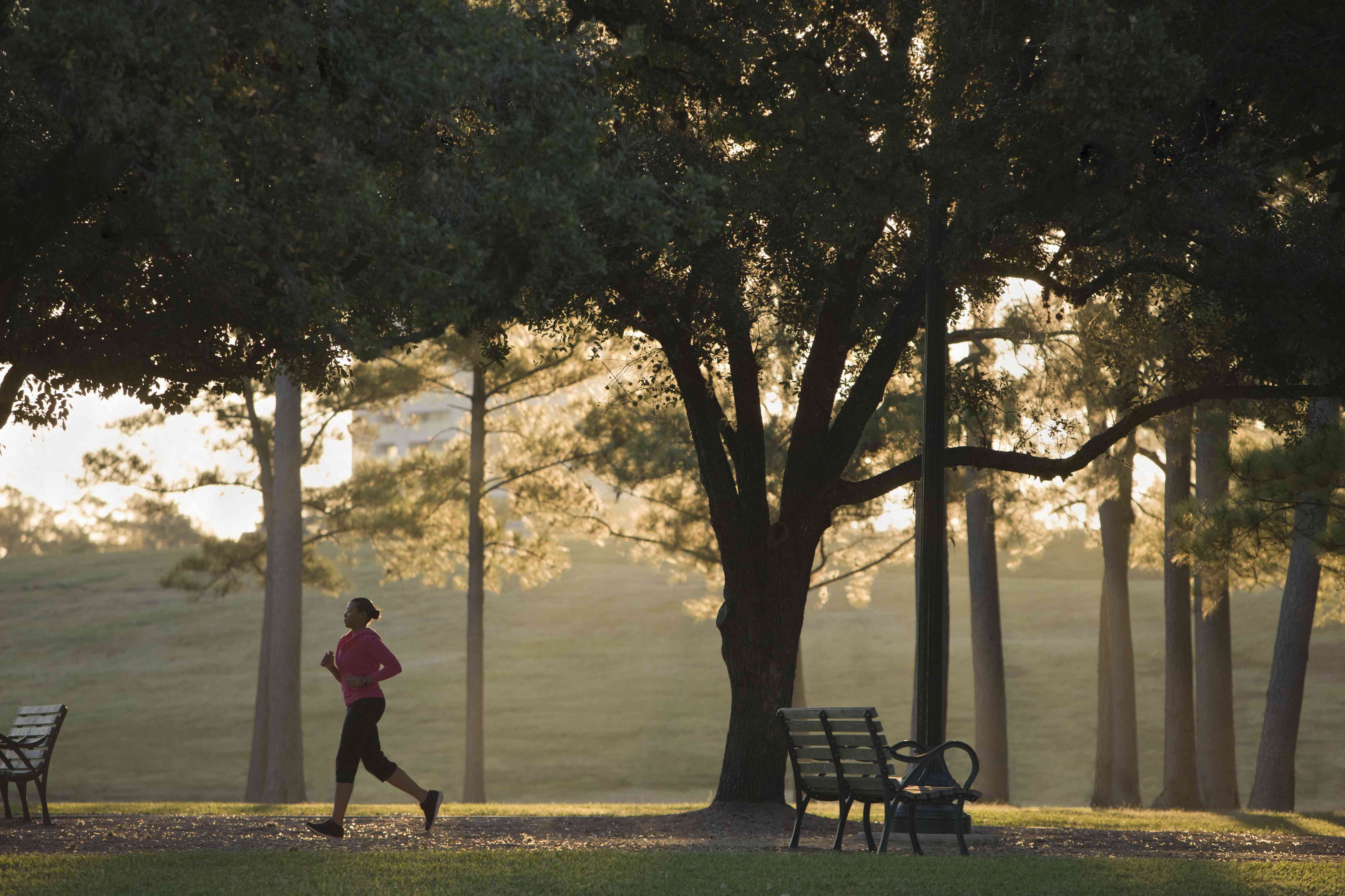 Woman running in park at dusk