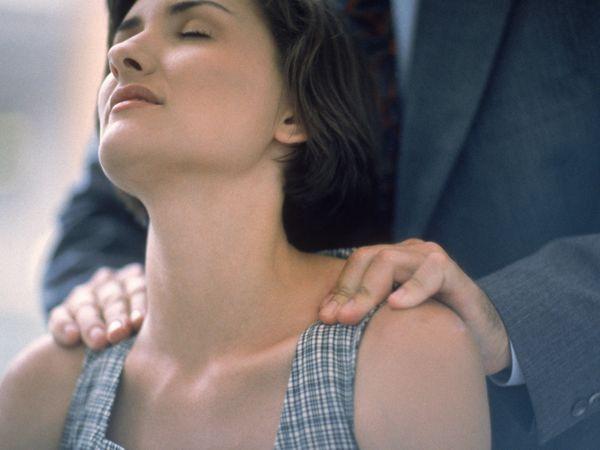 a man massaging a woman's neck