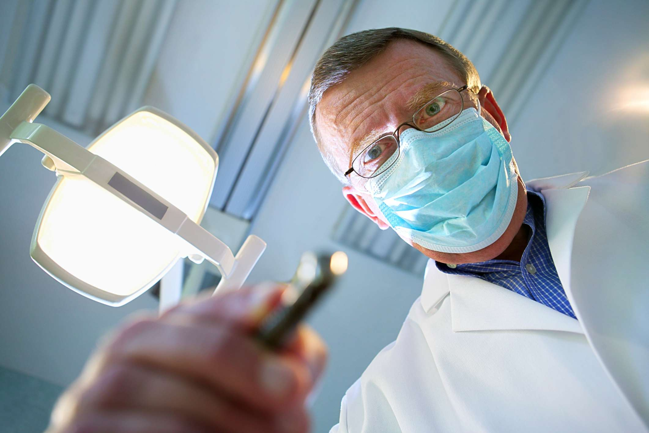 A dentist working - from the perspective of a patient