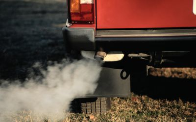 Pollution Coming from Exhaust Pipe of a Car