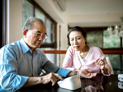 Senior couple takes blood pressure at home